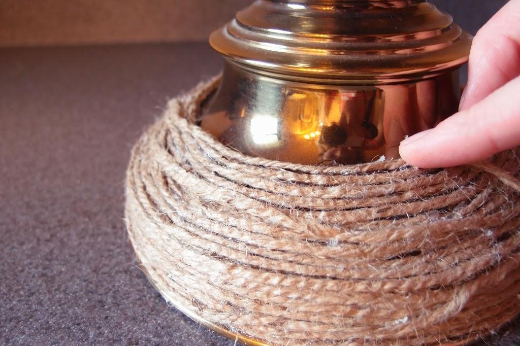 Pushing jute twine into place on lamp base