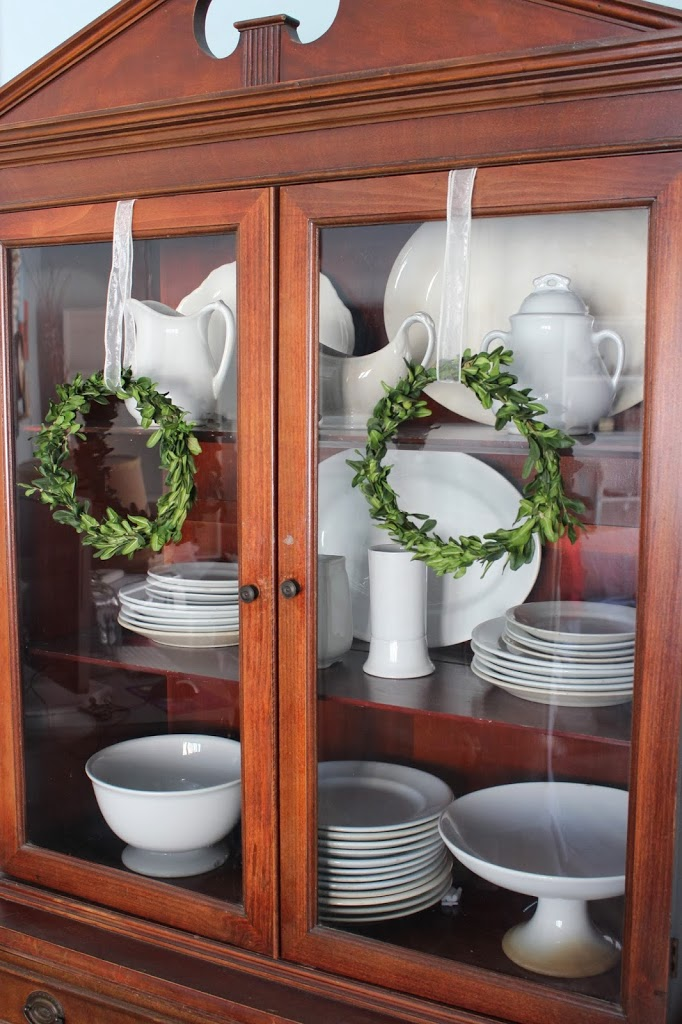 Dried boxwood wreaths on vintage cabinet doors