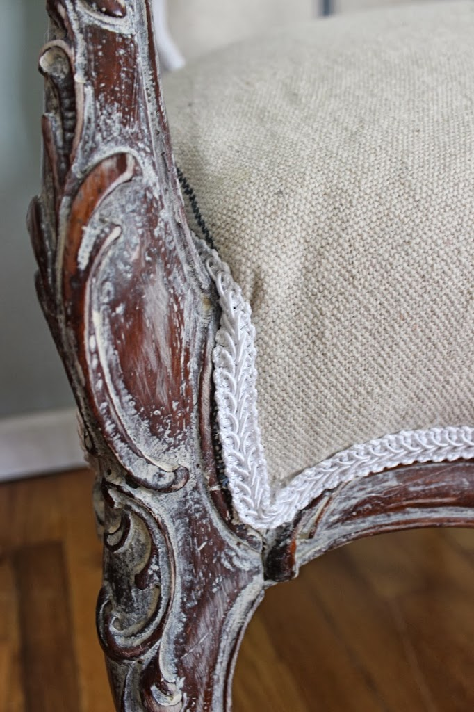 White washed frame of french chair and white gimp trim