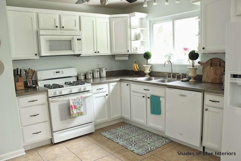 how to paint kitchen cabinets white makeover monday i painted my kitchen cabinets shades 17204