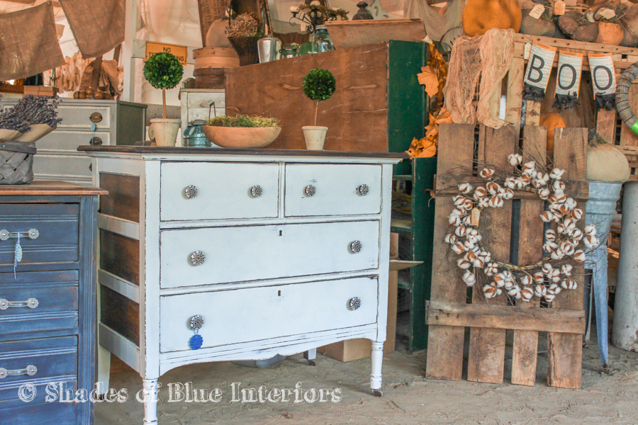 White dresser and a cotton stem wreath at a Vintage Market