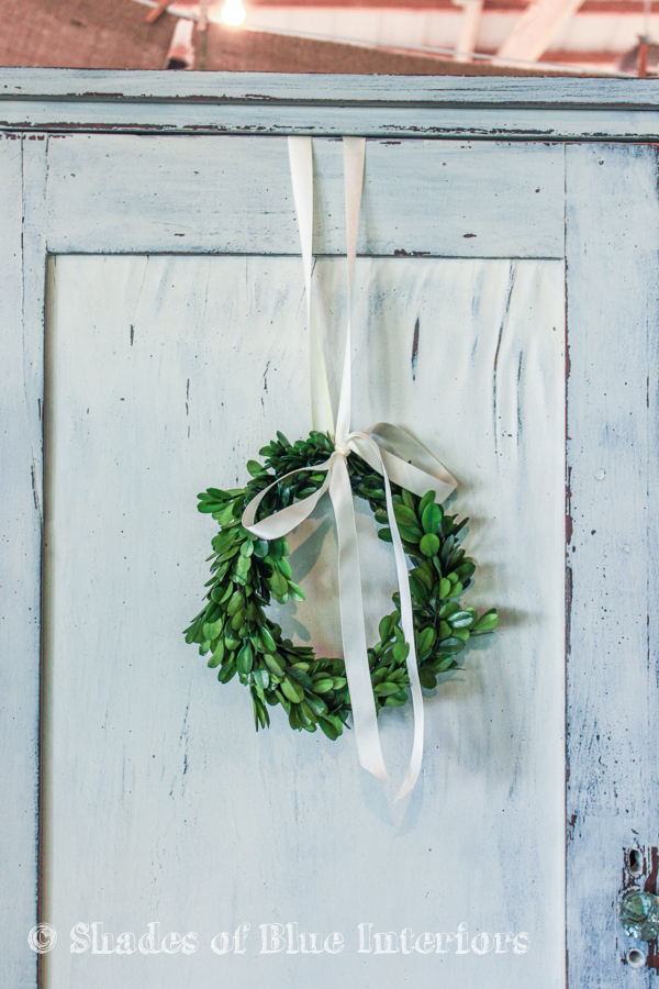 Painted armoire door with small boxwood wreath - Vintage Market
