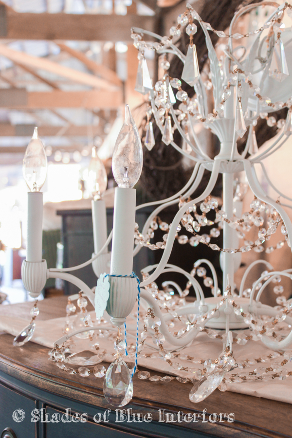 White crystal chandelier at a vintage market