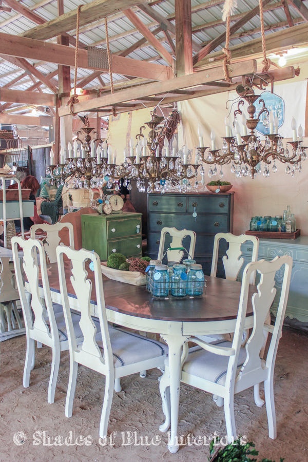 Vintage fair display idea - 3 crystal chandeliers hanging from a ladder over a french table set