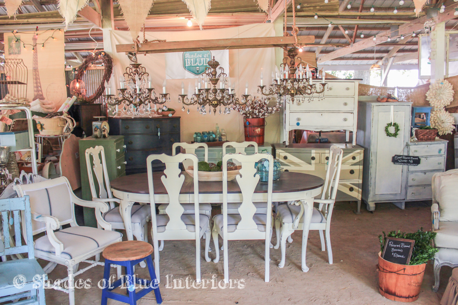 Vintage fair display idea - 3 chandeliers hanging from a ladder over a dining table