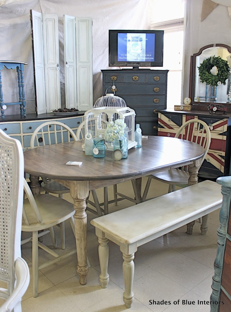 Creme and weathered gray dining set with birdcage and bottles on top in Shades of Blue Interiors booth