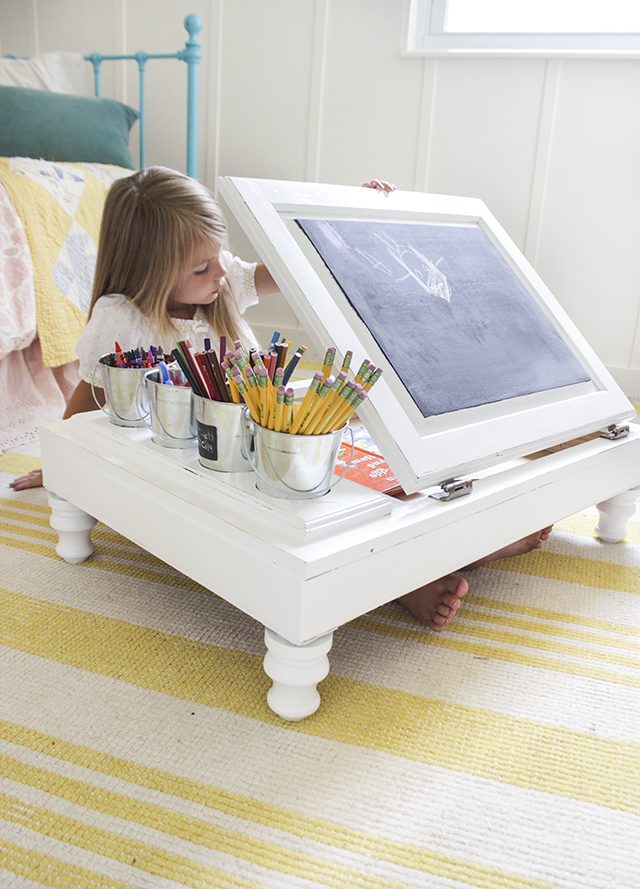 A discarded kitchen cabinet turned into a child's craft desk