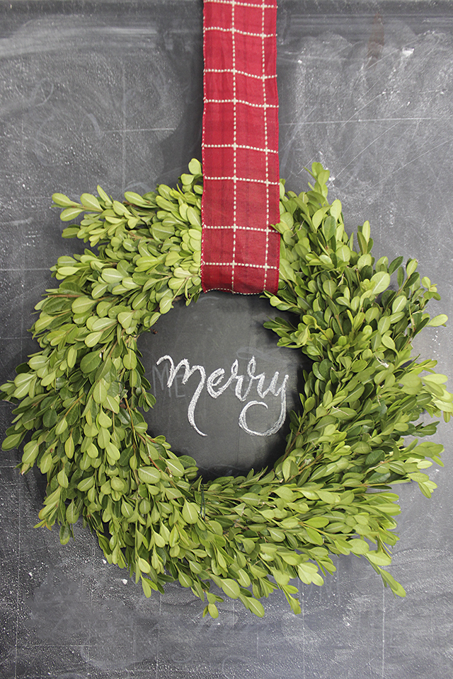 Boxwood wreath on chalkboard