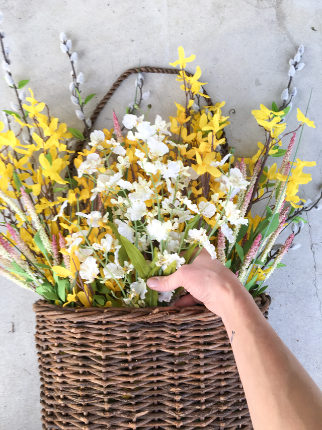 Adding-white-flowers to spring hanging basket