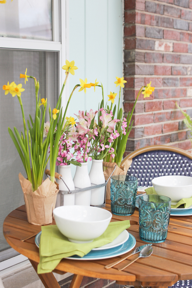Floral arrangement and place setting on small bistro table