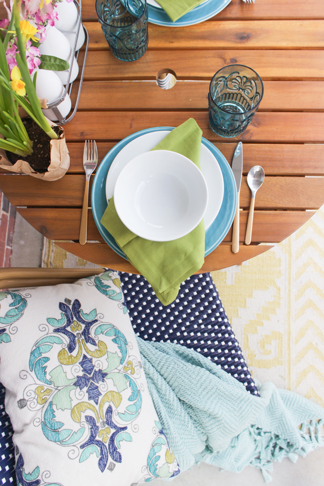 Spring place setting with aqua, teal, navy, green and yellow