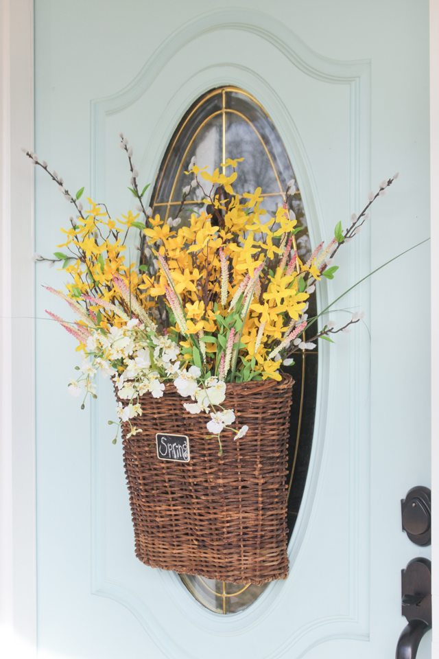 Spring Hanging Basket with forsythia on aqua door