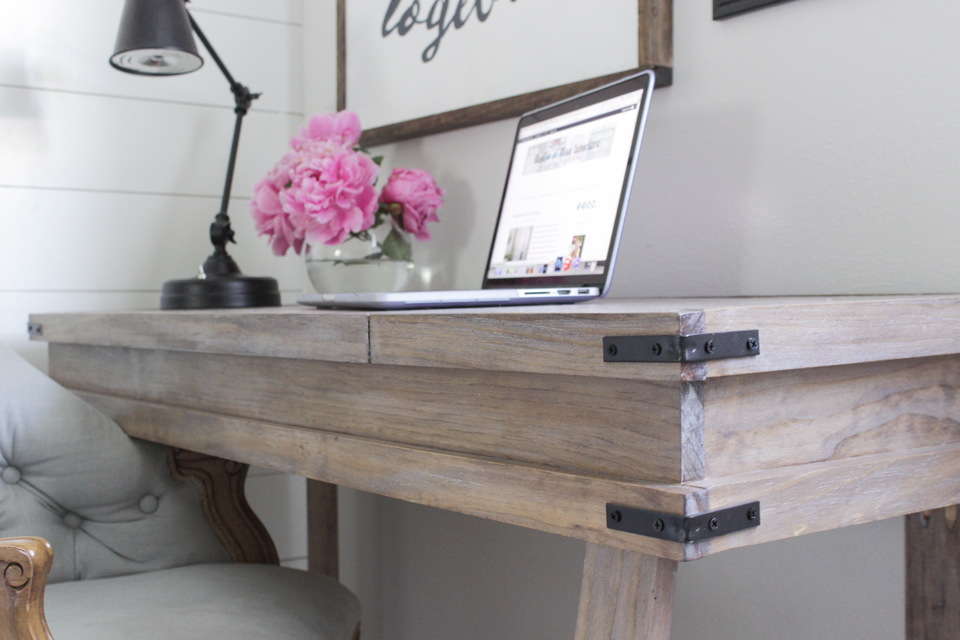 A white-washed wood finish with raised grain on a rustic desk