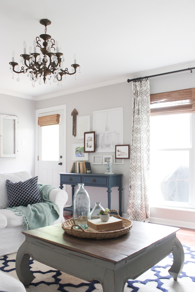 Bamboo shades in a living room with gray, navy, and white decor