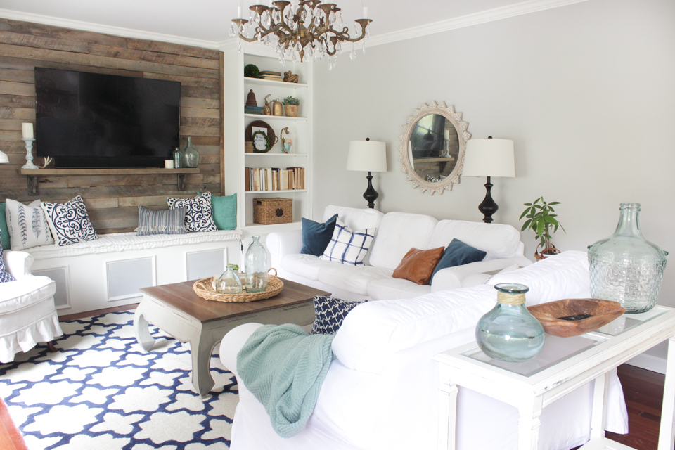 Intimate layout for living room with navy, aqua, and white color palette