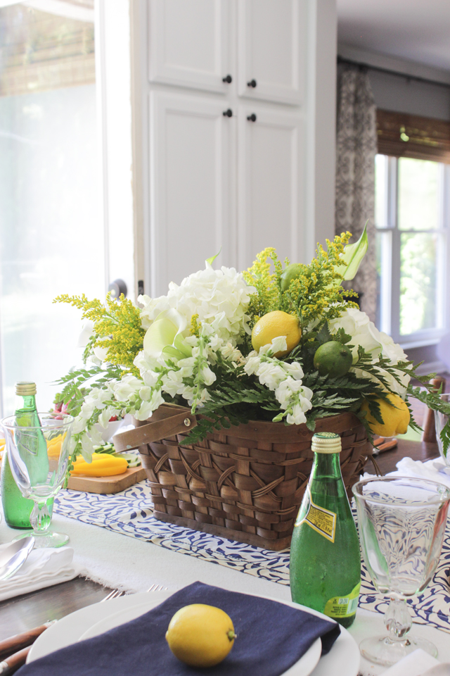 Summer floral arrangement with lemons and limes