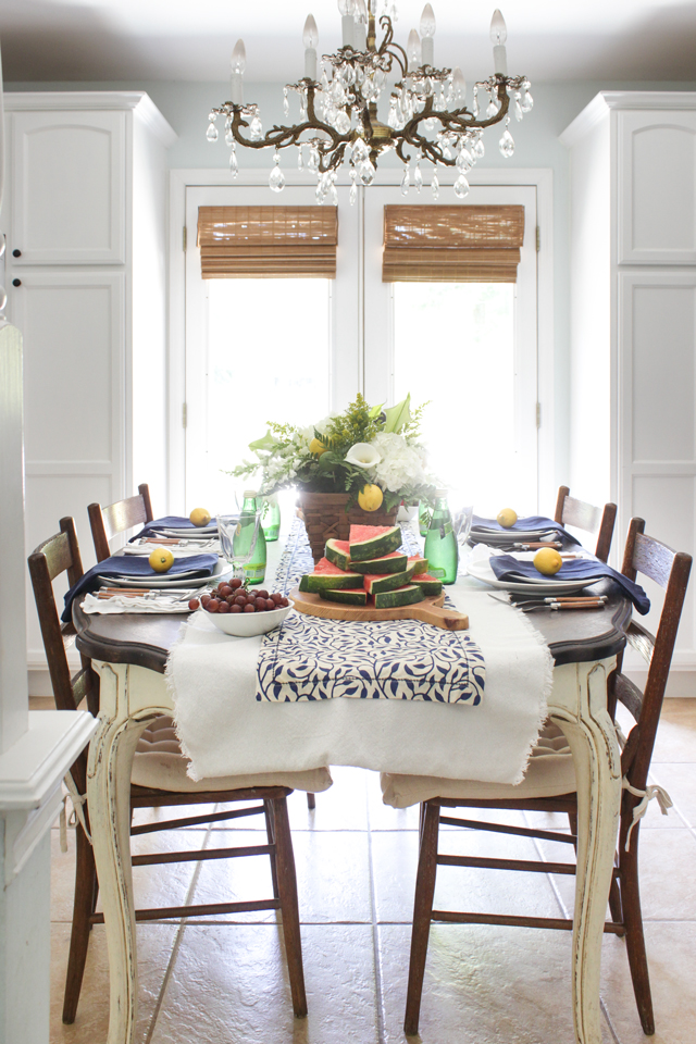 Summer tablescape with navy, white, green and lemons