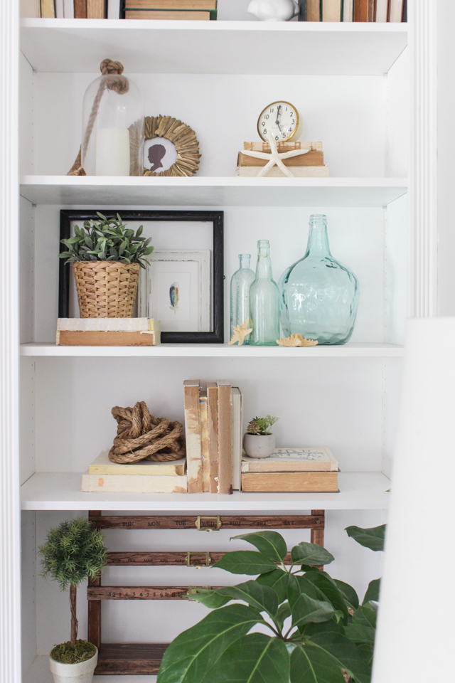 Styled bookcase with neutral coastal decor
