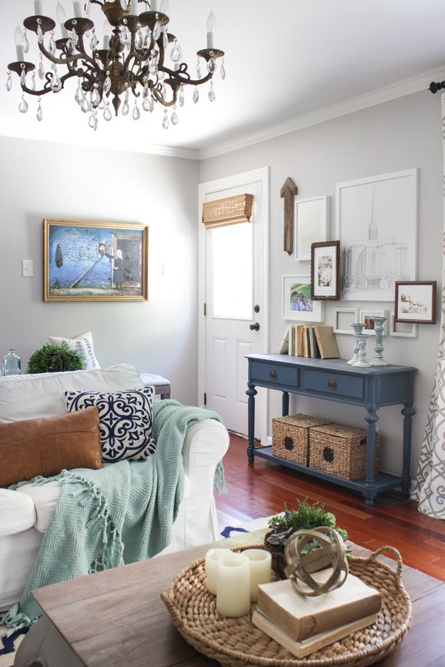 Layered gallery wall over console table