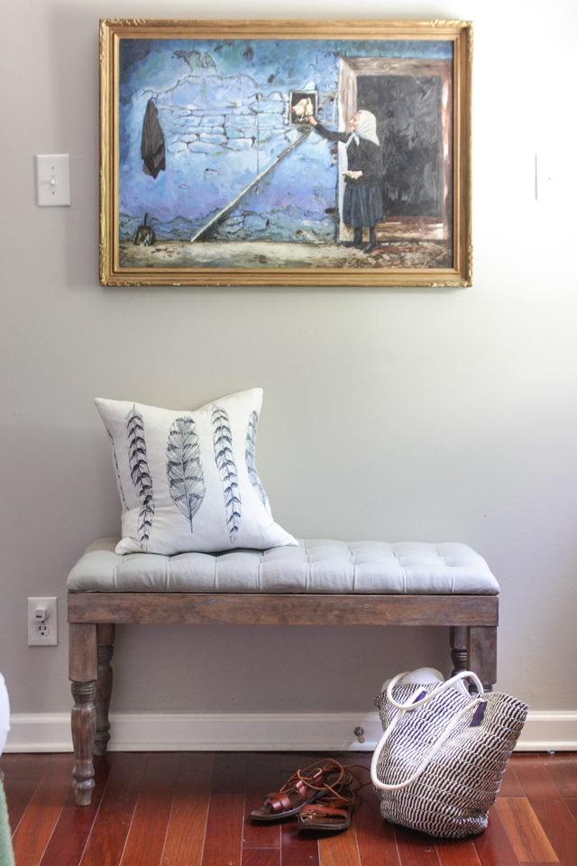 Oil painting over tufted bench