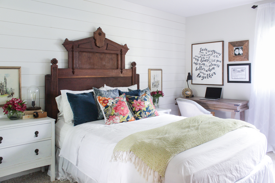 Master bedroom with Eastlake vintage headboard, floral pillows and desk