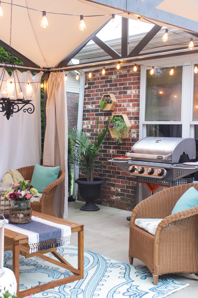 Stok Grill by pergola on summer patio with hex planters