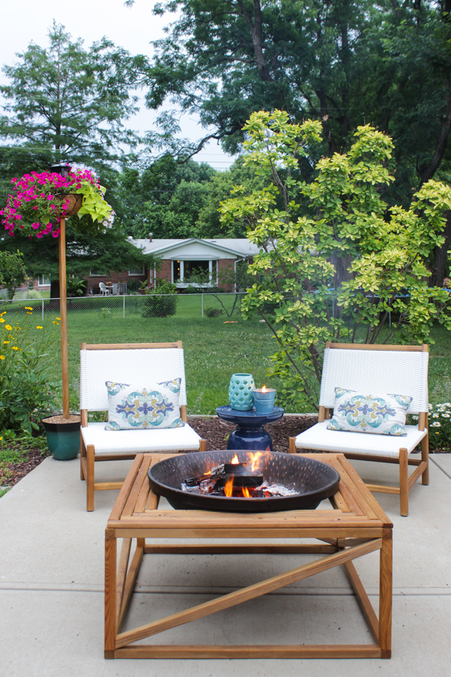 Outdoor fire pit with seating area and solar light pole