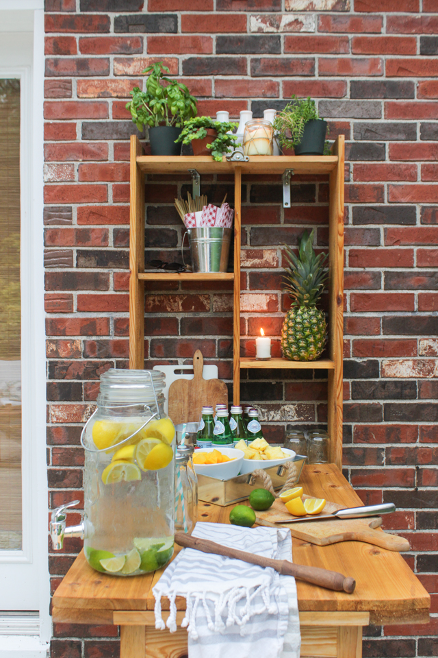 Outdoor murphy bar set up with fruit kebobs and lemon-lime water
