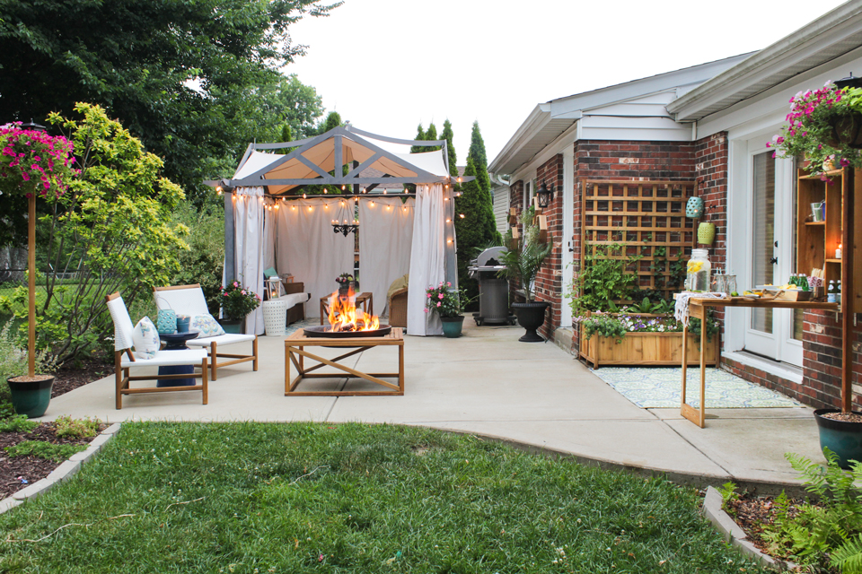 Patio with pergola, grill, seating area, fire pit, murphy bar, and planter with trellis