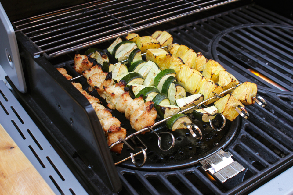 Stok Quattro grill with grilled pineapple, grilled zucchini, and grilled chicken kebobs