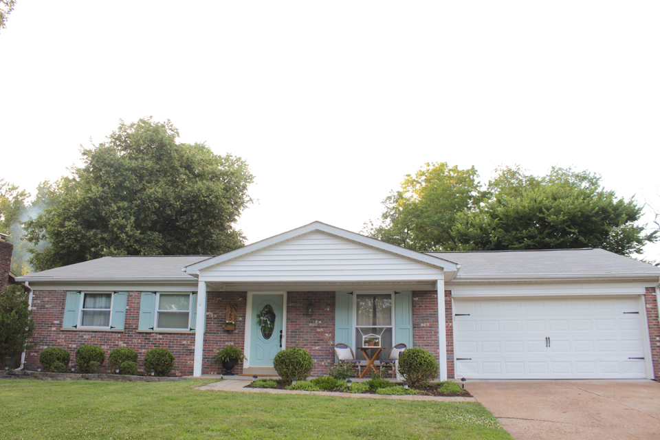 Brick ranch updated with craftsman style shutters