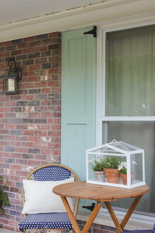 Craftsman style shutters with small bistro set on front porch