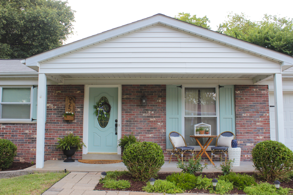 Aqua Craftsman style shutters on brick ranch house