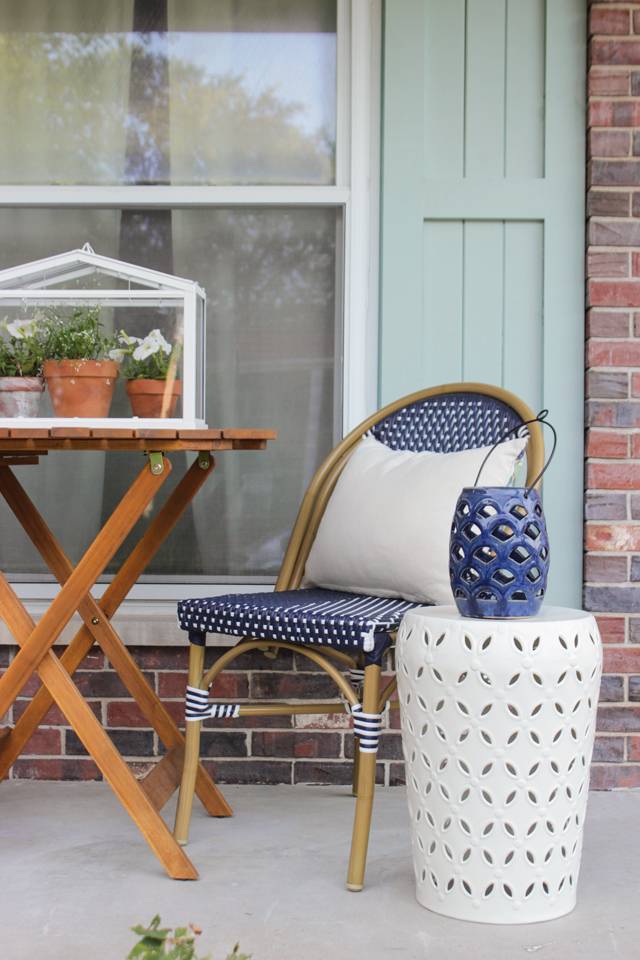Navy bistro chair and drum stool on front porch
