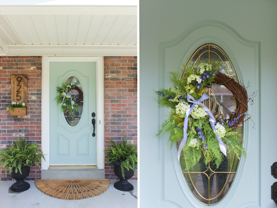 Aqua front door with floral wreath
