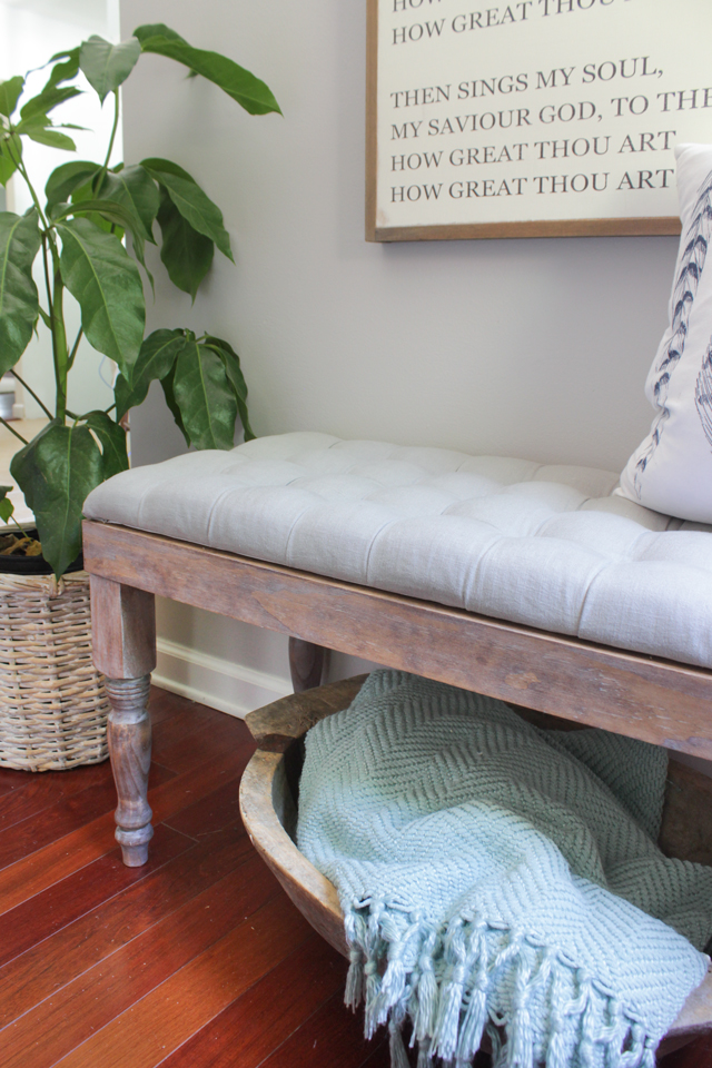 DIY gray tufted bench with white-washed weathered wood base