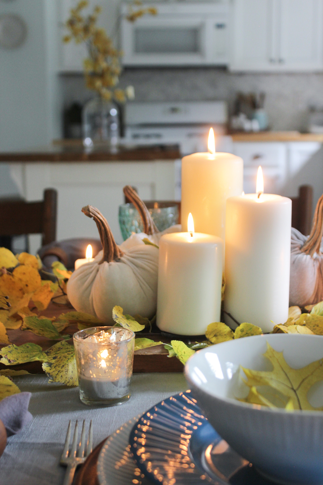 Cozy pillar candles on a fall tablescape