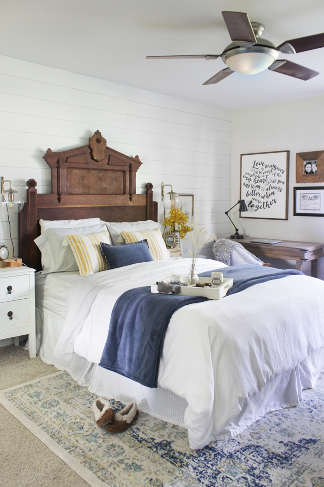 Fall master bedroom with statement Eastlake headboard, navy, gray, and golden yellow