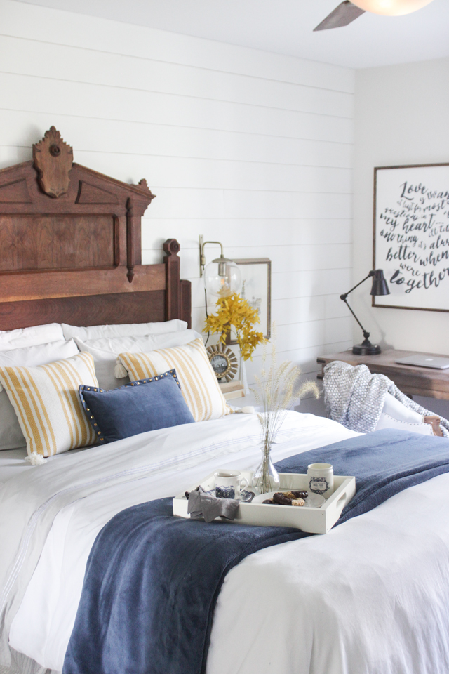 Fall bedroom with statement headboard, blue and yellow accent colors