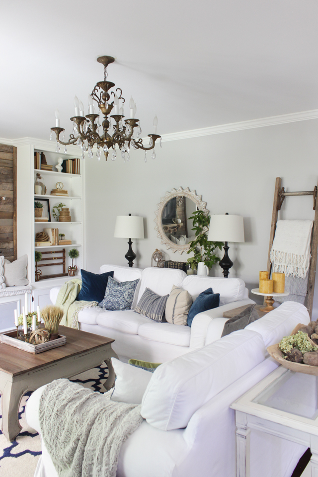Farmhouse Living room decorated for fall with navy, green, gray, and a pop of yellow