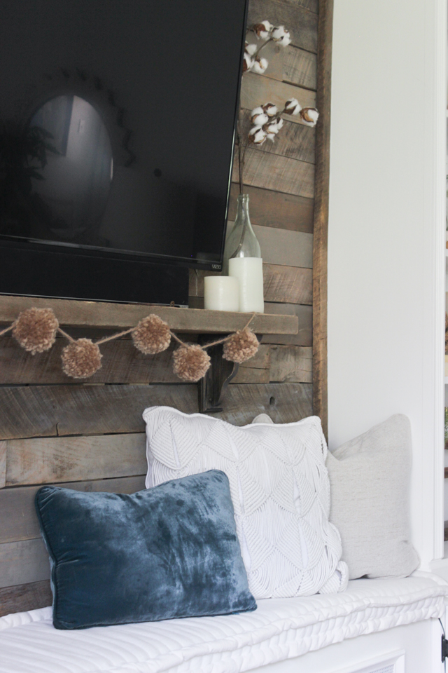 Pallet accent wall behind TV with bench below - fall family room
