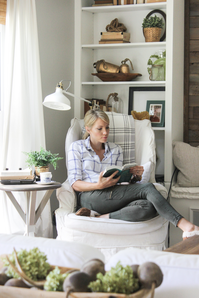 Reading nook in a slipcovered wing chair