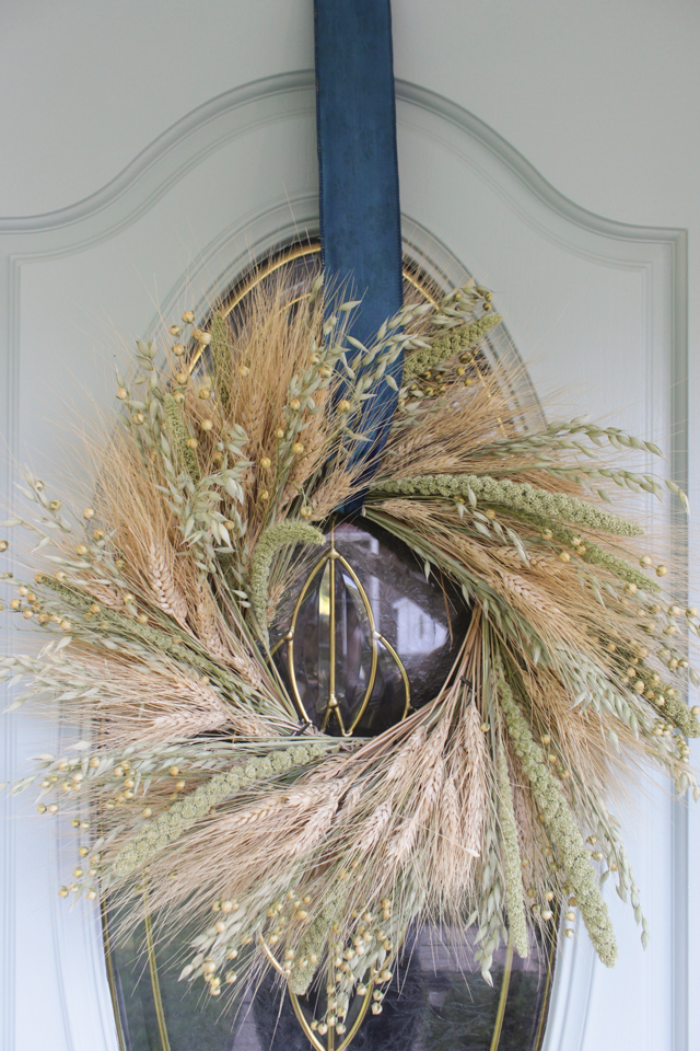 Wheat wreath for fall on an aqua front door