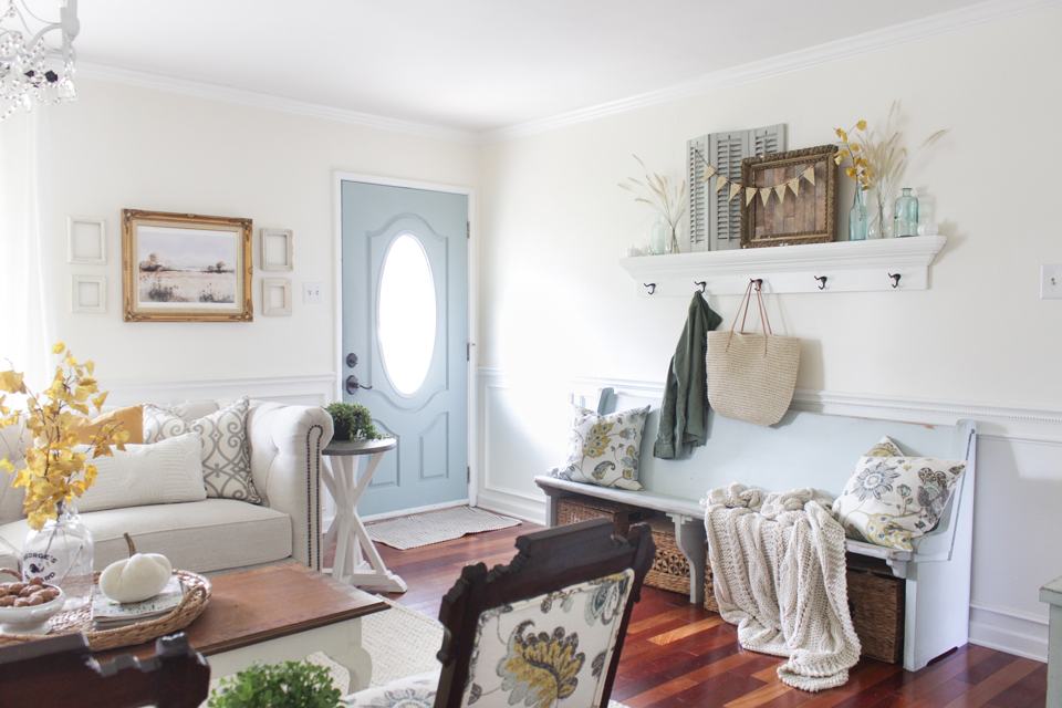 Fall entry bench with shelf above, and blue front door