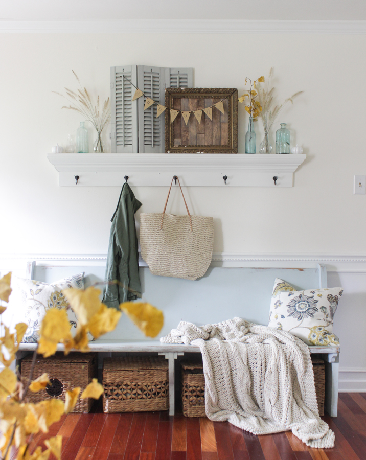 Fall Entry shelf with aqua church pew bench and cozy cable knit blanket