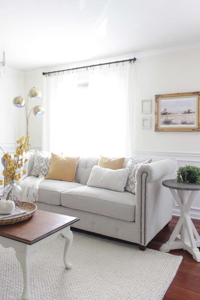 Tufted chesterfield sofa with subtle fall decor