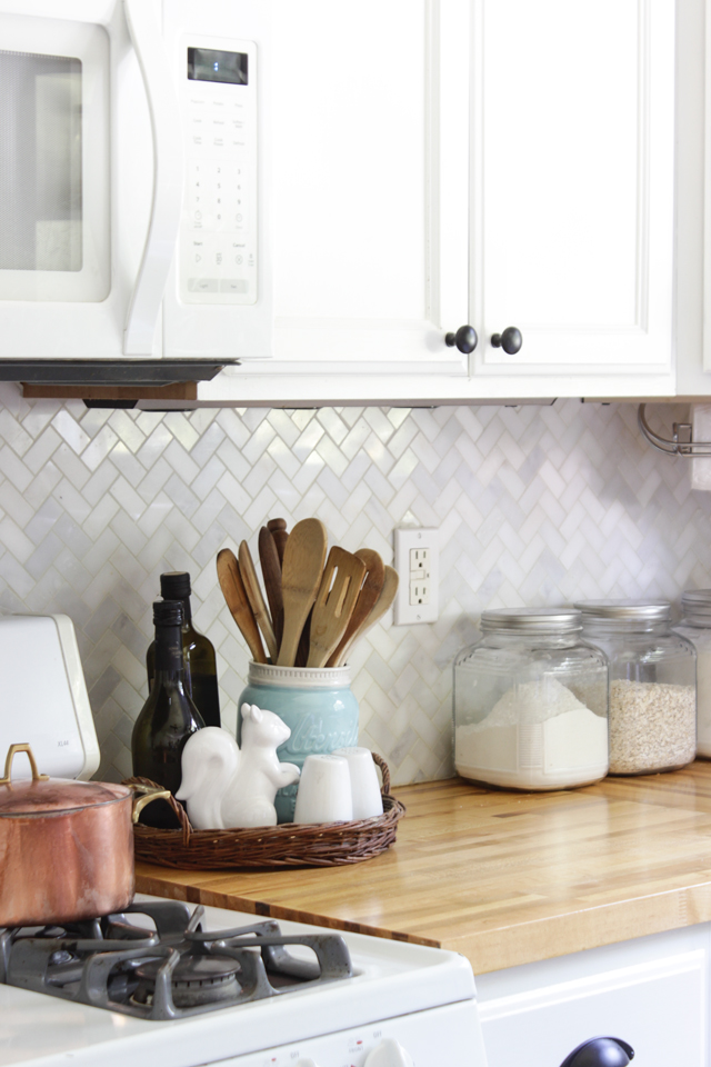 Herringbone marple backsplash, farmhouse accents, butcher block counters