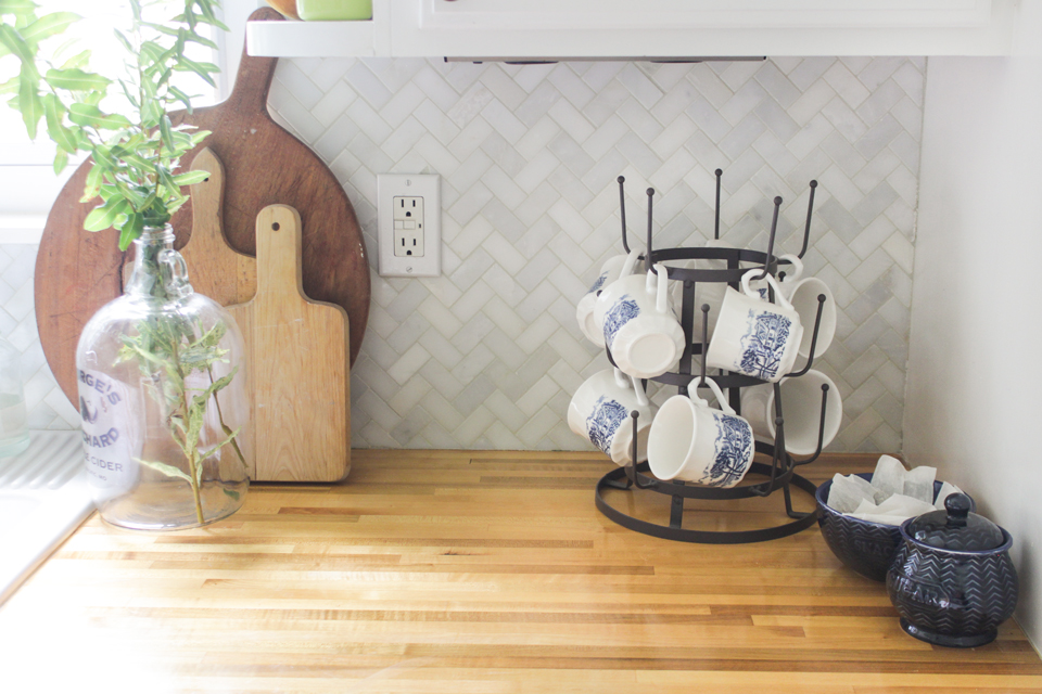Farmhouse fall kitchen with teacup holder, herringbone backsplash