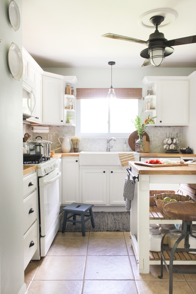 Fall farmhouse kitchen with apron front sink, butcher block counters, white cabinets