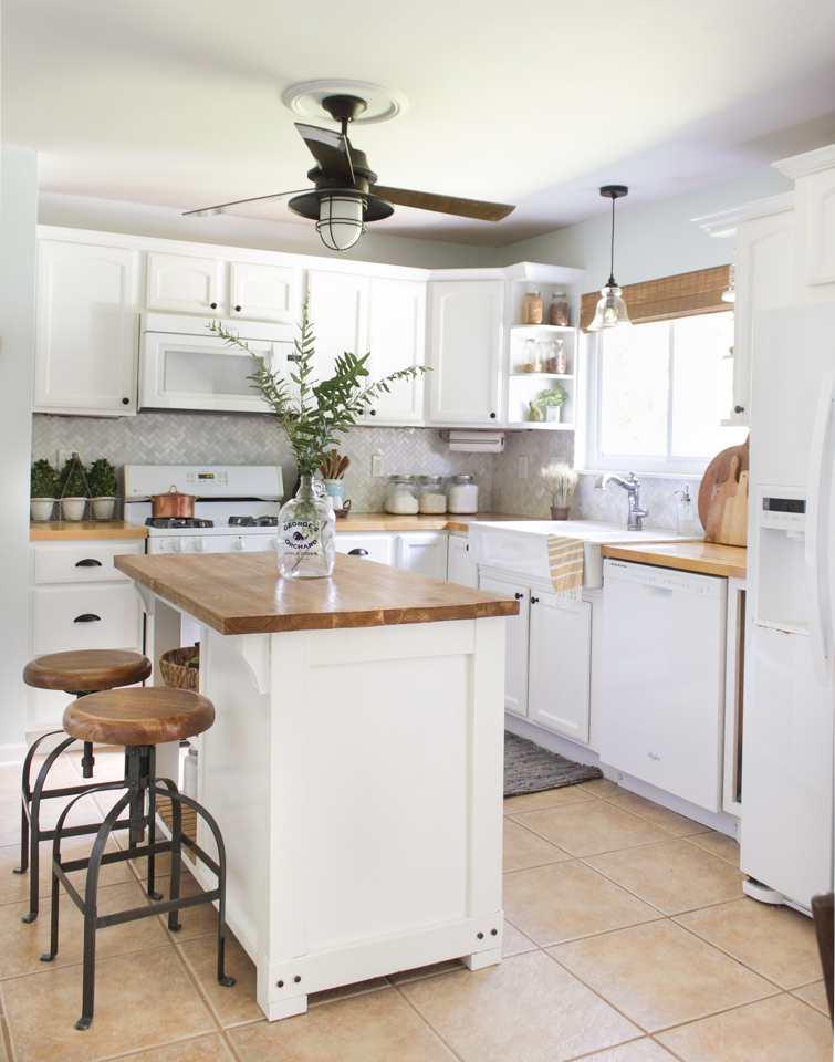 Fall Farmhouse kitchen with white cabinets, butcher block counters, apron front sink